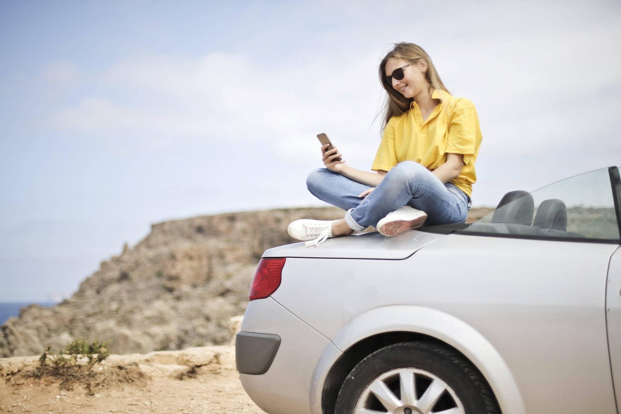Girl Preparing Road Trip on Car