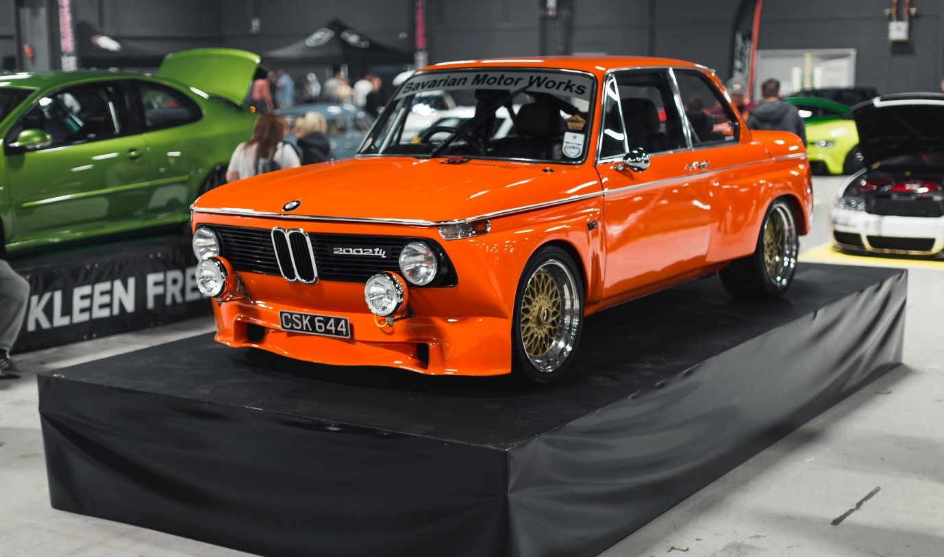 Classic orange BMW car on the sShow and Shine stand at FittedUK